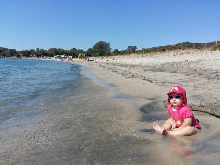 Beach Sand Vacations Summer Sea Sunny People Water Swimming Childhood One Baby Baby On The Beach Pink Color One Woman Only Clear Sky Travel Destinations Outdoors Leisure Activity Portrait Child Gviarizzo Corse Du Sud