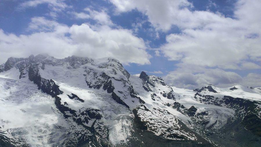 High angle shot of snowed rocky landscape
