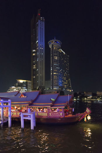 Building Exterior Illuminated Architecture Night Water Built Structure City Office Building Exterior Building Waterfront Skyscraper Nautical Vessel Nature Transportation Travel Destinations Modern River Tall - High Outdoors Cityscape Luxury Financial District  Bangkok Thailand ASIA