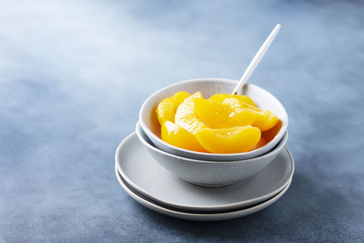 Close-up of yellow fruit in bowl on table