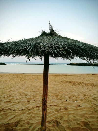 Water Tree Sea Beach Sand Thatched Roof Sky Horizon Over Water Beach Umbrella Parasol Umbrella Palm Tree