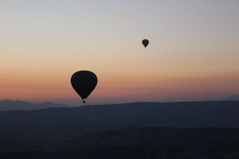 Sunrise Air Vehicle Sky Hot Air Balloon Sunset Balloon Transportation Mid-air Scenics - Nature Tranquil Scene Flying Nature Silhouette Adventure Mountain Landscape Travel