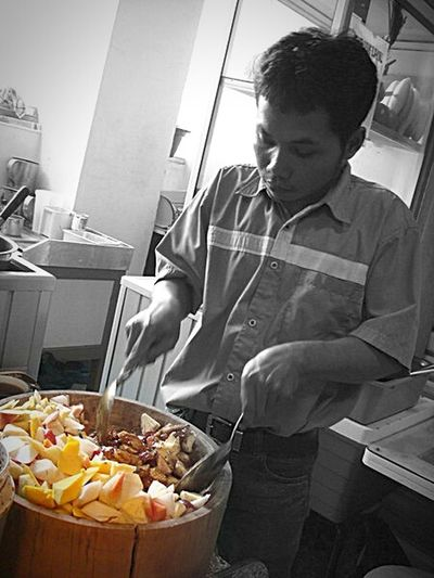 Mixing Rujak Aceh - A traditonal Acehnese Fruit Salad with rough-ground Peanut & palm sugar Dressings - on a barrel | Observing People Portrait Portrait Photography From My Point Of View My City, My Life Localfood Local Culture Localstyle Fruit Salad Jakarta Indonesia Pastel Power EyeEm Portraits