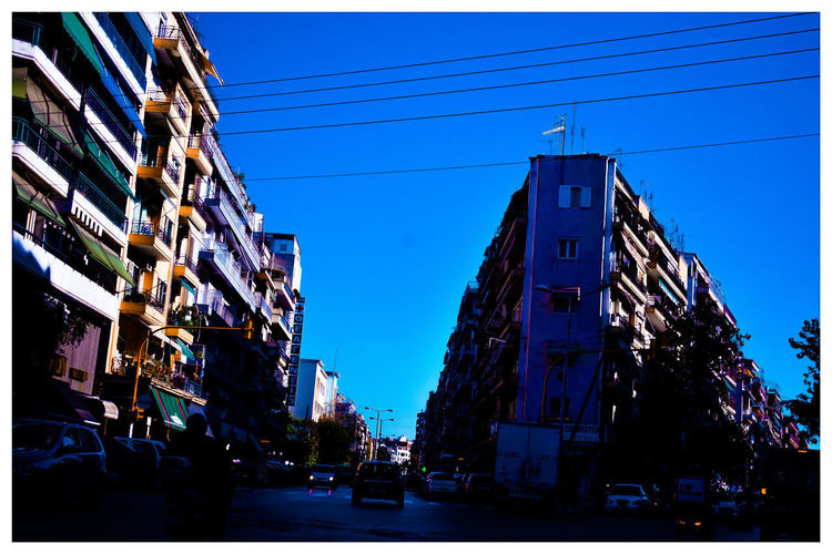 urban Architecture Sky Built Structure Building Exterior Outdoors Illuminated Clear Sky Car City People Real People Day NewHere ✌🏽️😄
