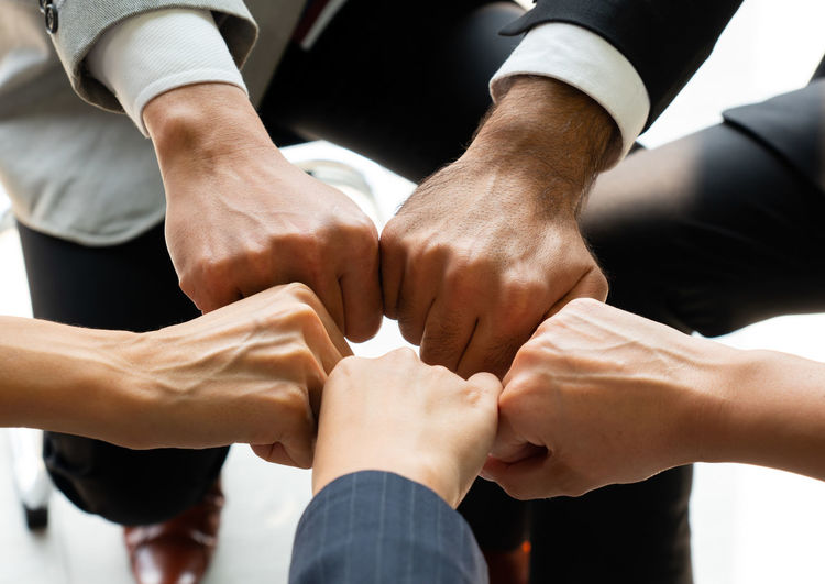 Cropped image of business persons doing fist bump