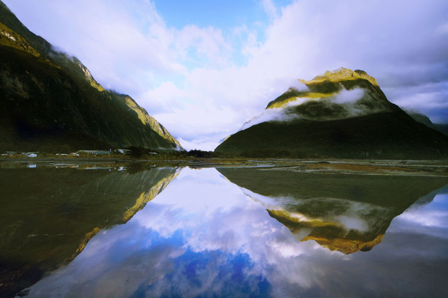 Milford Sound, New Zelaand Beauty In Nature Cloud Cloud - Sky Day Idyllic Lake Landscape Milford Sound Mist Mountain Nature New Zealand No People Outdoors Reflection Reflection Reflection Lake River Scenics Sky Standing Water Symmetry Tranquility Tranquility Water