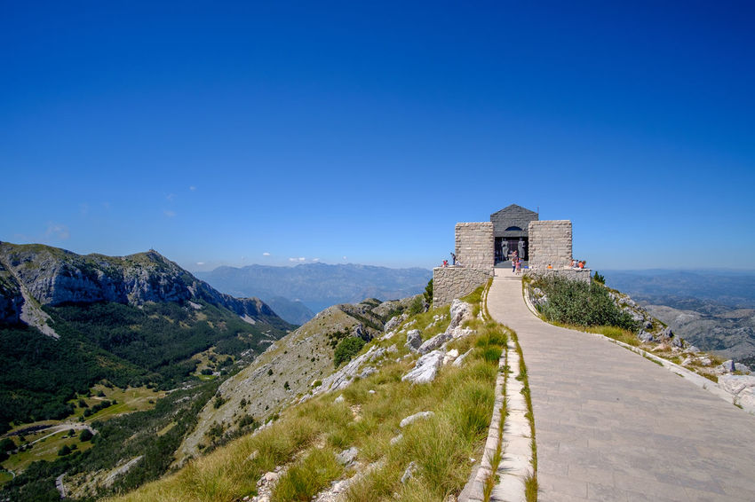 Njegosev Mauzolej Architecture Beauty In Nature Blue Building Exterior Built Structure Castle Clear Sky Day History Lovcen Montenegro Mountain Nature Njegos Mausoleum No People Outdoors Place Of Worship Scenics Sky Travel Destinations Water