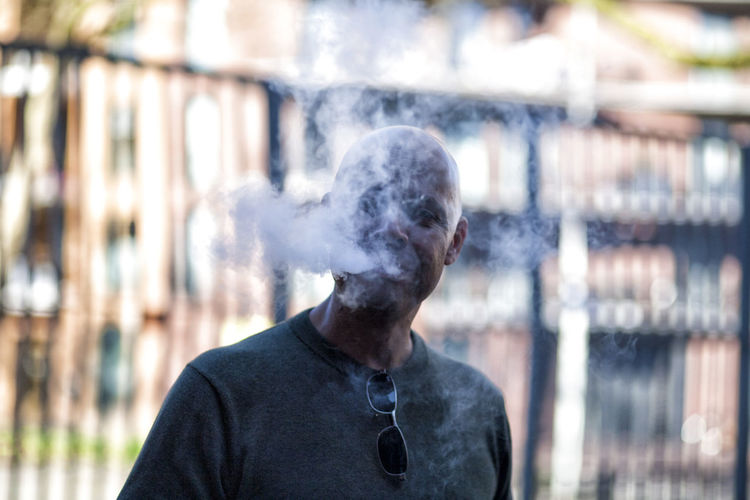 BLUESMOKE Day Front View Headshot Leisure Activity One Man Only One Person Outdoors Smoke Smoke - Physical Structure Smokeintheface Smoking