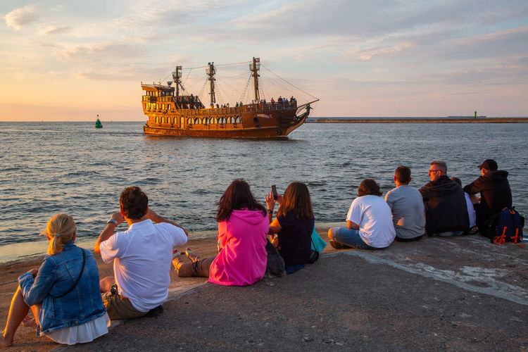 Baltic Sea Adult Child Cloud - Sky Group Of People Horizon Over Water Leisure Activity Looking At View Men Mode Of Transportation Nature Nautical Vessel Outdoors Real People Rear View Sea Sitting Sky Sunset Togetherness Transportation Water Women