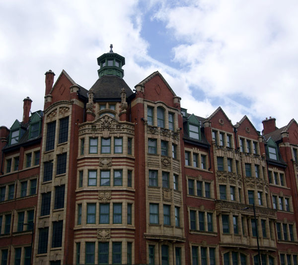 Architectural detail in Manchester, UK Manchester Northern Quarter Sky Building Exterior Built Structure Architecture Cloud - Sky Low Angle View Window Building No People City The Past Nature Day History Outdoors Travel Destinations Residential District In A Row Travel Old Apartment