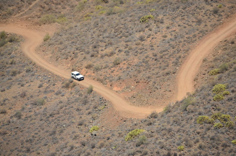 High Angle View Of Off-Road Vehicle On Dirt Road