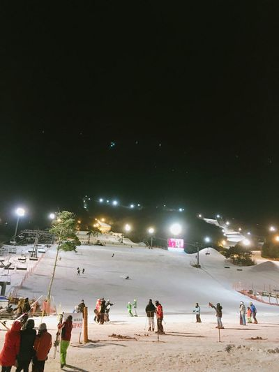 MuJu Snowboarding Snow Night Cold Outside With Ma Hus Korea Large Group Of People Winter Lifestyles Leisure Activity Cold Temperature Real People Building Exterior Sky Outdoors Mixed Age Range Illuminated City Men Nature Ice Skate People Ice Rink