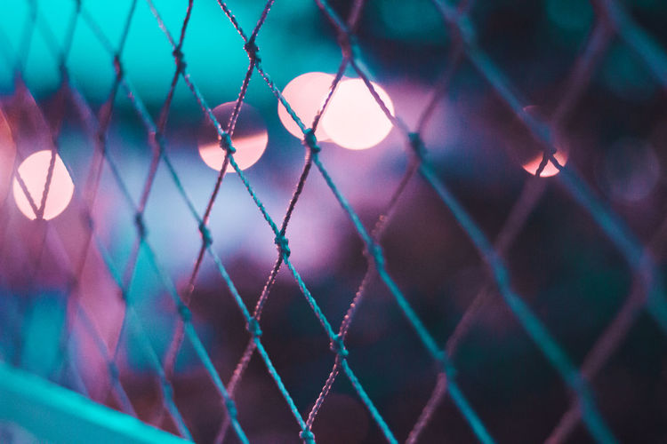 Colors Lights Bokeh Bokeh Lights Chainlink Fence Close-up Day Focus On Background Focus On Foreground Illuminated Metal Night No People Outdoors Pattern Protection Safety Security Sky Fresh On Market 2017
