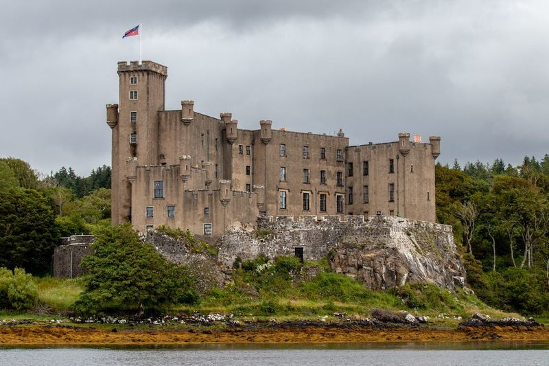 Dunvegan Castle, Isle of Skye, Scotland Dunvegan Castle Dunvegan Isle Of Skye Scotland Castle Architecture Water Sky Built Structure Building Exterior Plant Tree Waterfront History Travel Destinations