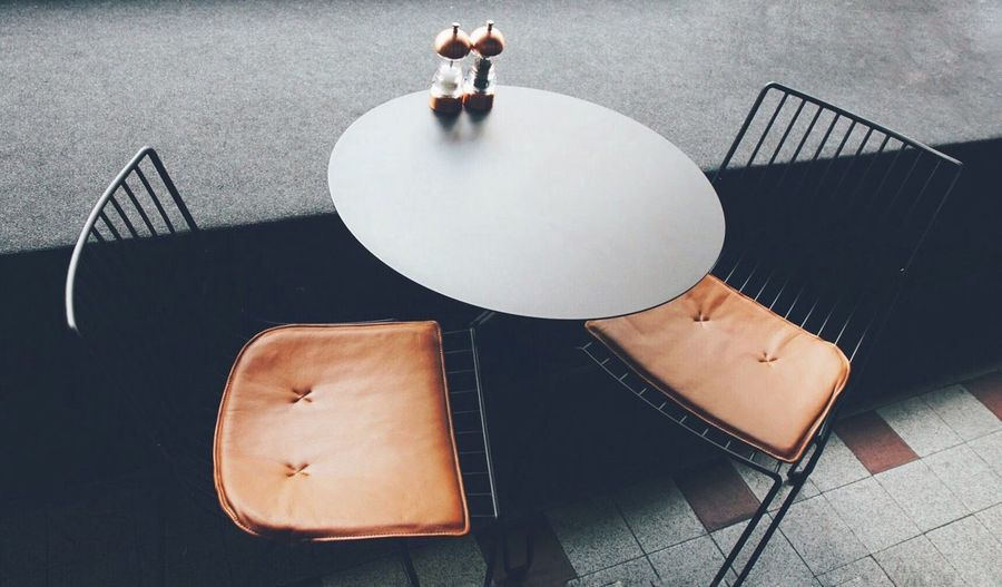 High Angle View Of Empty Chairs And Table At Side Cafe