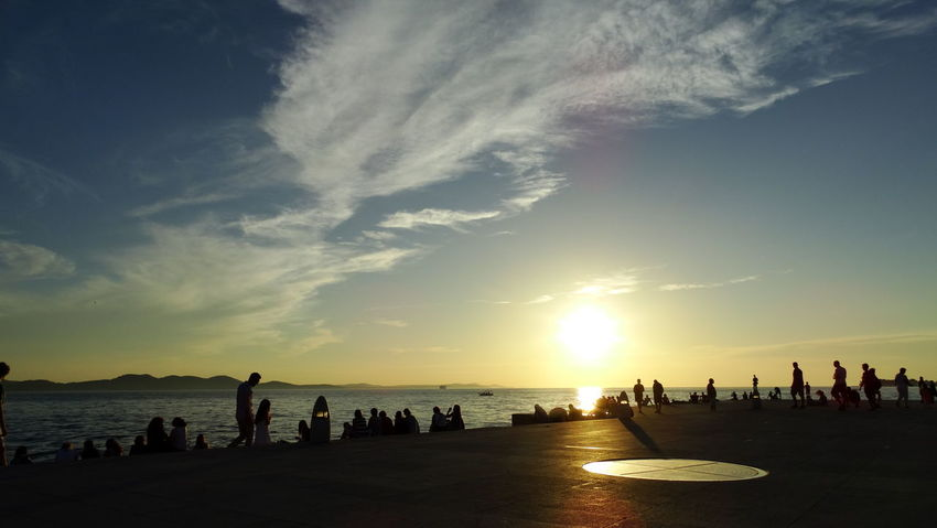 Summer In The City Beach Beauty In Nature Cloud - Sky Crowd Group Of People Land Large Group Of People Leisure Activity Lifestyles Men Nature Outdoors Real People Scenics - Nature Sea Silhouette Sky Sunset Water Women