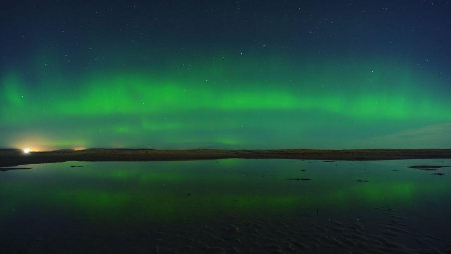 Aurora polaris against sky at night