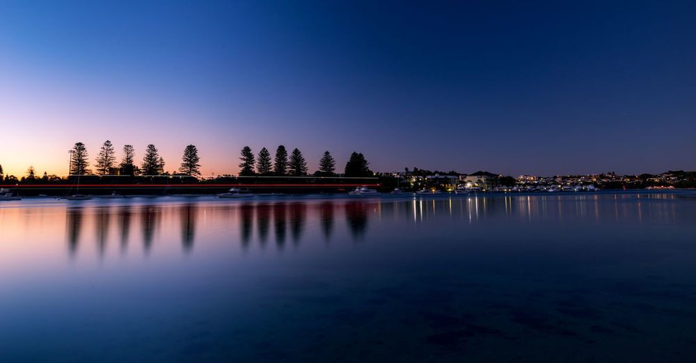 Boat light trail in swan river Calm Nikon Serenity Architecture Beauty In Nature Blue Built Structure Clear Sky Lake Lighttrail Longexposure Nature Night No People Outdoors Reflection Scenics Sky Sunset Tranquil Scene Tranquility Travel Destinations Tree Water Waterfront Mobility In Mega Cities