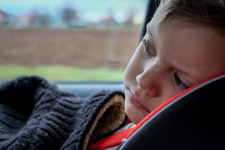 Blond Hair Boys Child Childhood Children Only Close-up Day Focus On Foreground Fujifilm FUJIFILM X-T10 Headshot Interior One Boy Only One Person People Portrait Son Tired Transportation Traveling Home For The Holidays Wasiak Uniqueness