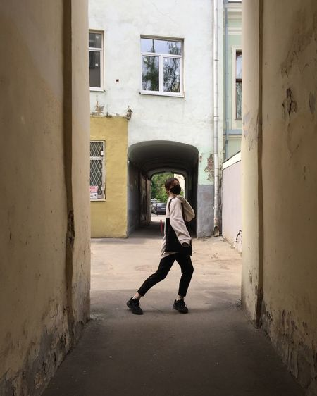 Full length of man walking against building