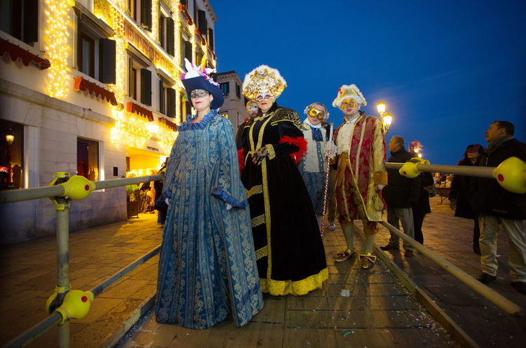 Carnival Carnival In Venice Venice, Italy Adult Architecture Building Exterior Built Structure Carnival Masks Celebration City Costume Full Length Holding Illuminated Leisure Activity Mask - Disguise Men Night Outdoors People Performance Period Costume Real People Sky Stage Costume Standing Togetherness Venetian Event Venetian Masks Women