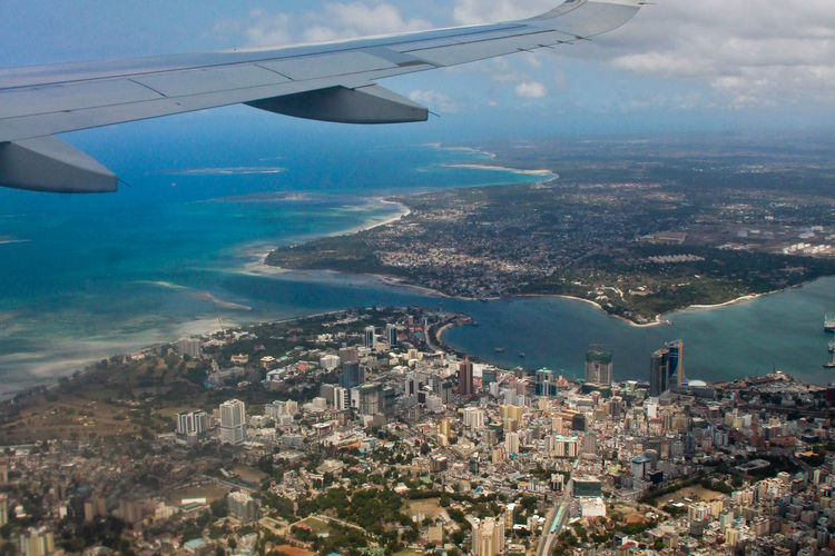 Aerial View Air Plane Aircraft Wing Airplane Airplane Wing Beaches City Cityscape Coast Coastline Day Downtown Flying Journey Landscape Mountain Nature No People Outdoors Plane Sea Sky Tanzania Transportation Window View