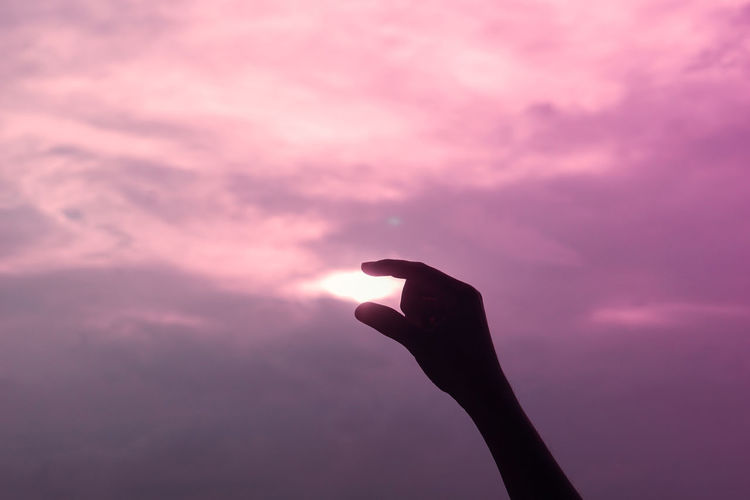 Silhouette person against pink sky during sunset