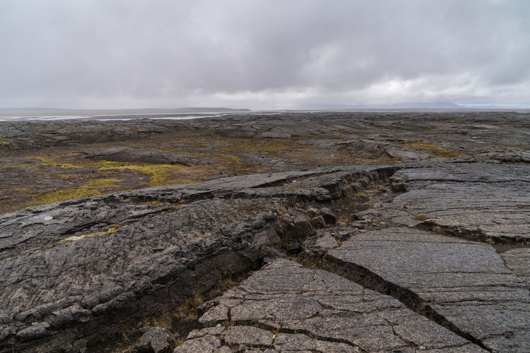 Iceland Beautifuliceland Beauty In Nature Cloud - Sky Day Environment Geology Gray Land Landscape Lava Field Lava Field Iceland Low Tide Nature No People Non-urban Scene Outdoors Rock Rock - Object Scenics - Nature Sea Sky Solid Water