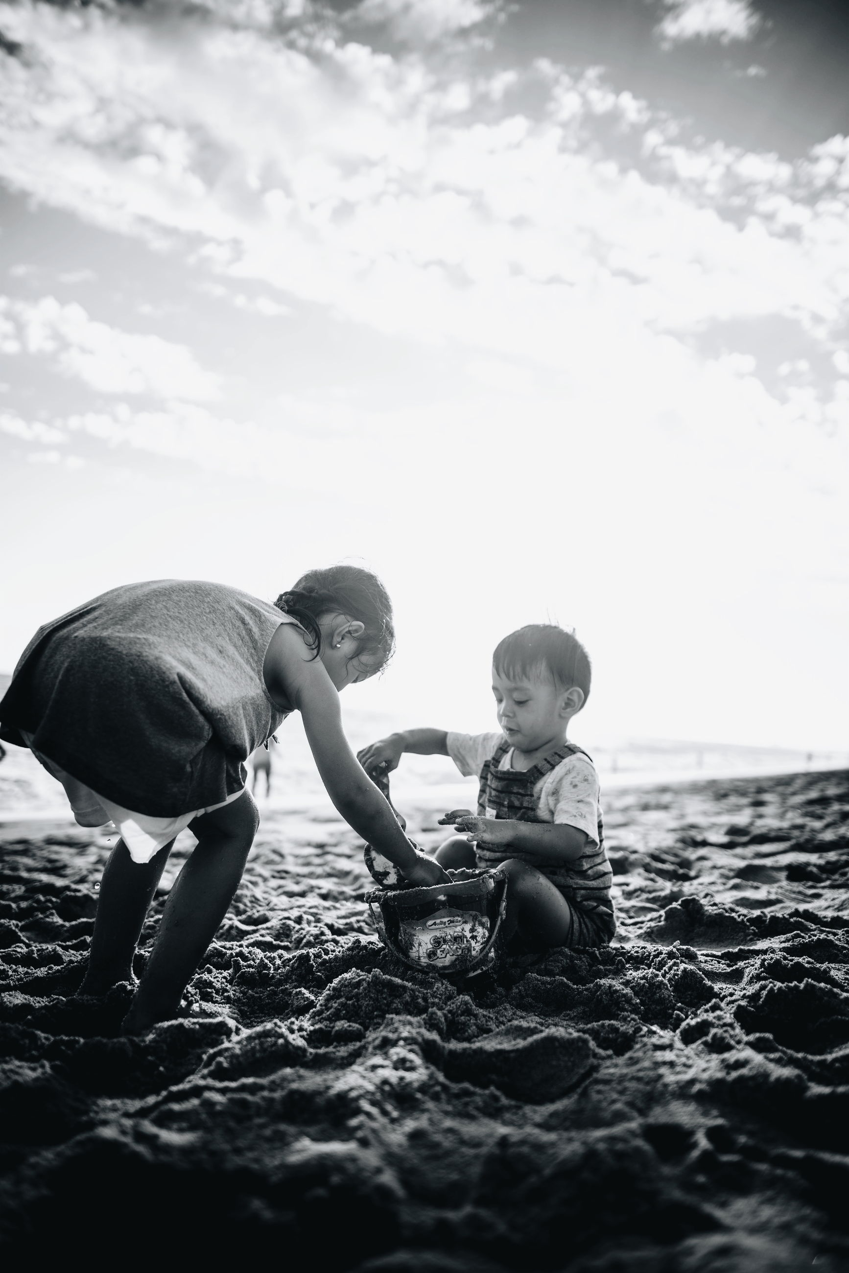 childhood, boys, family, sky, two people, full length, day, casual clothing, outdoors, togetherness, sibling, happiness, father, bonding, girls, real people, nature, smiling, people