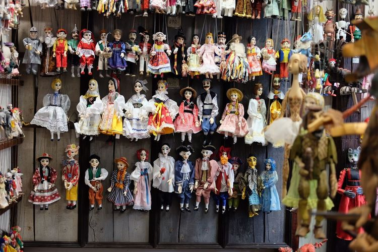 Variety of dolls for sale at market