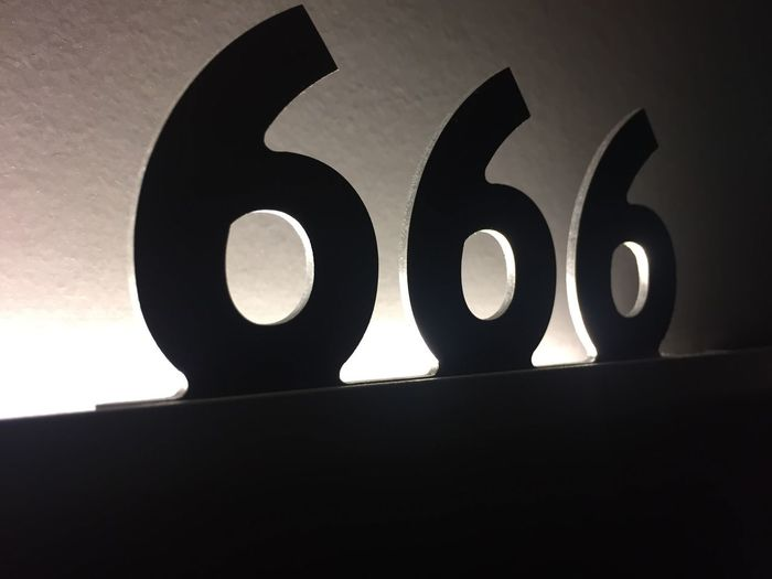 No People Low Angle View Close-up Text Indoors  Numbers Hotel Tripple Six Sixes