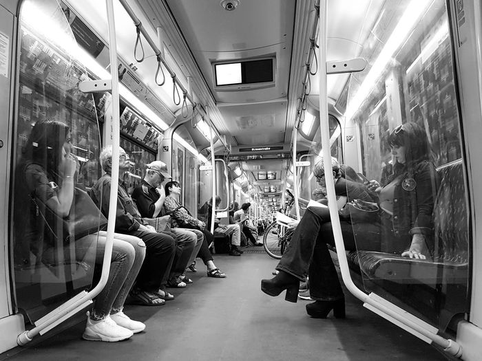 Blackandwhite Black And White Black And White Photography Public Transportation Vehicle Interior Group Of People Real People Rail Transportation Train Transportation Train - Vehicle Crowd Mode Of Transportation Vehicle Seat Sitting Illuminated Seat Large Group Of People Passenger Subway Train Commuter Adult Go-west-photography.com