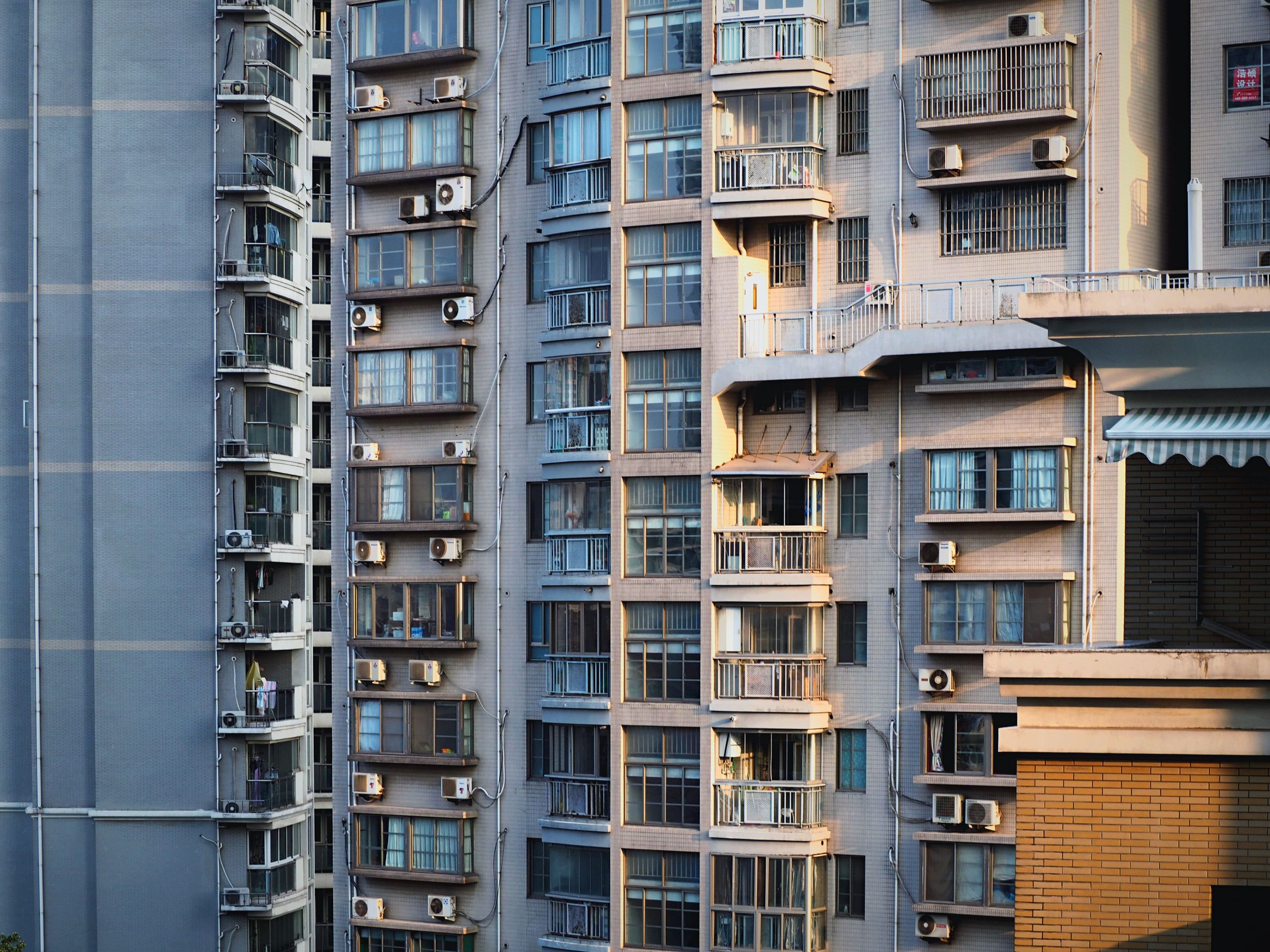 architecture, building exterior, built structure, window, city, building, apartment, residential building, residential structure, full frame, low angle view, balcony, modern, in a row, repetition, office building, city life, backgrounds, day, no people