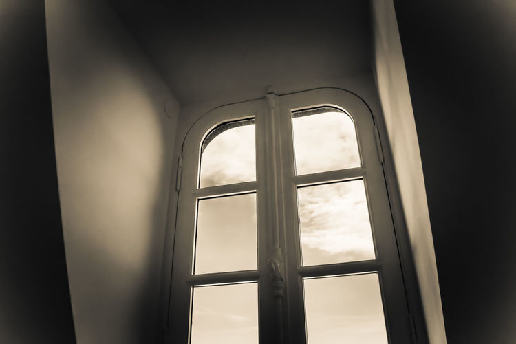 Parisien window Window Indoors  Architecture Day Glass - Material Transparent No People Built Structure Building Low Angle View Arch Nature Sunlight Security Close-up Safety Sky Protection Window Frame Interior Shutters White Light And Shadow Europe France Paris Dramatic Sky Clouds Shape