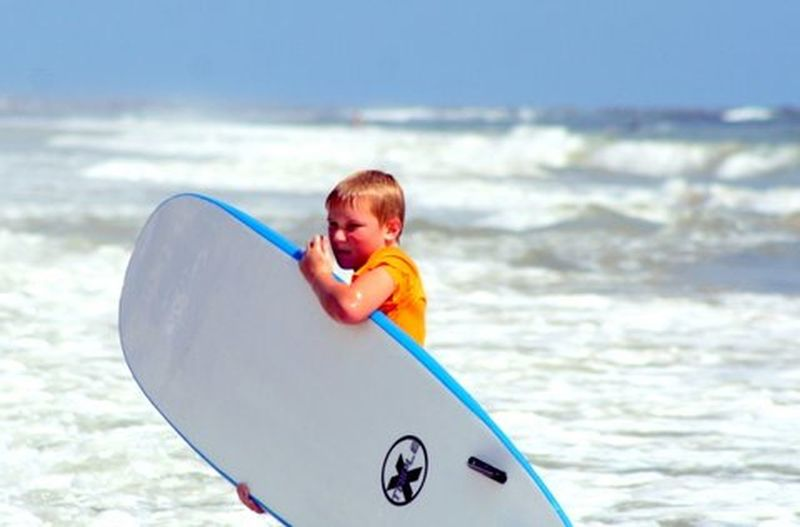 Surfing lessons Enjoying The Sun Boy With Surf Board Beach Scene  Surfer Boy Surf's Up