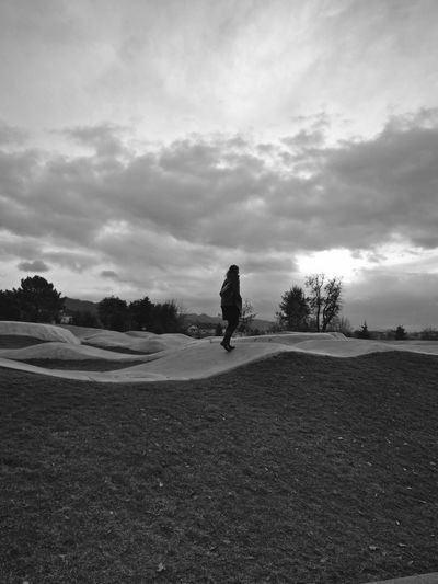 Silhouette man on field against sky