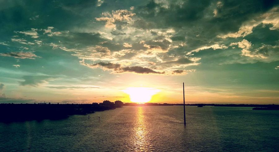 Sunset Cloud - Sky Dramatic Sky Sky Scenics Nature Sunbeam Tranquility No People Sunlight Tranquil Scene Water Landscape Reflection Outdoors Sun ClouTravel Destinations Tree Horizon Over Water Marco Island Sunset Florida Beautiful Beauty In Nature