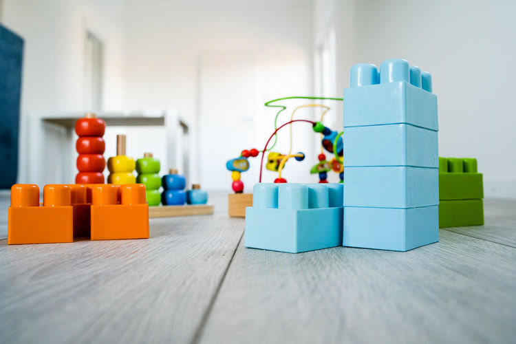 Indoors  Still Life Toy Table Multi Colored Toy Block Wood - Material No People Close-up Selective Focus Home Interior Focus On Foreground Plastic Choice Flooring Built Structure Architecture Group Of Objects Large Group Of Objects