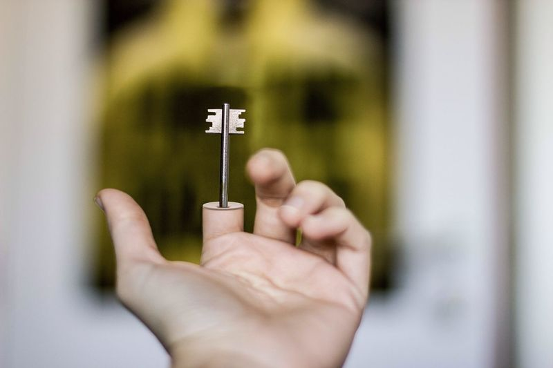 Optical Illusion Of Hand With Key