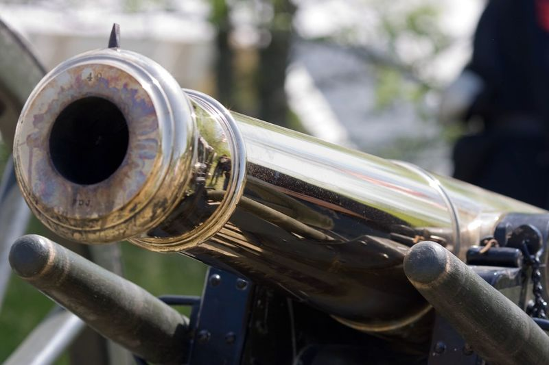 Close-up of metallic cannon outdoors