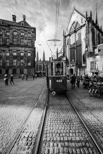 Tram @ Dam Square Track Railroad Track Rail Transportation Mode Of Transportation Transportation Architecture Building Exterior Built Structure Cable Car City Public Transportation Real People Group Of People Land Vehicle Sky Street Men Day People Incidental People Outdoors Waiting