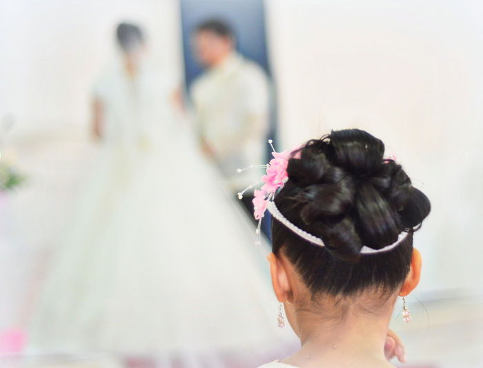 Rear View Of Woman With Hair Bun At Wedding Celebration