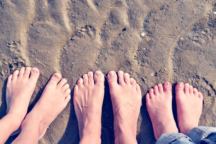 Child Childhood Three EyeEm Selects Low Section Water Nail Polish Beach Togetherness Sand Bonding Sea Summer Human Leg Toenail Foot Feet Human FootPrint Human Toe Beach Holiday Sandy Beach Human Feet Toe