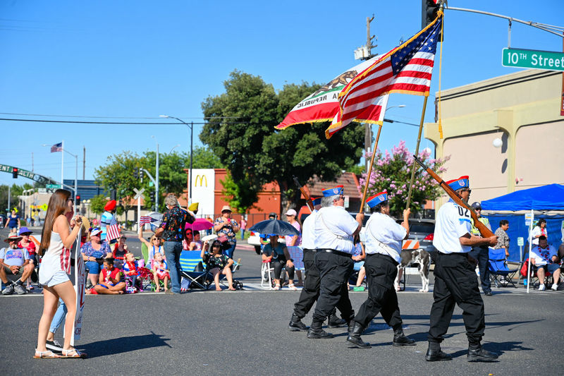 The Celebration of Independence Day during 4th of July At down town Modesto California, the March of the Veterans. Group Of People City Crowd Patriotism Real People Street Large Group Of People Flag Architecture Building Exterior Day Men Sky Built Structure Nature Women Lifestyles Striped Outdoors Independence Streetphotography