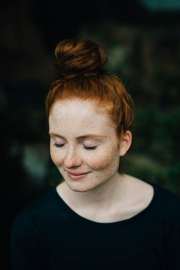 Adult Adults Only Beautiful People Beautiful Woman Beauty Close-up Fragility Freckle Green Color Hair Bun Headshot Lifestyles One Person One Woman Only One Young Woman Only Only Women Outdoors People Portrait Real People Redhead Smiling Women Young Adult Young Women