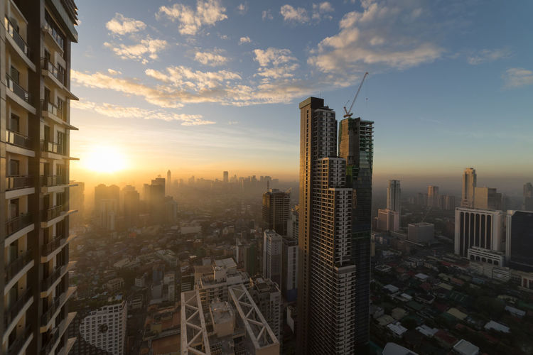 Morning sun at Manila ASIA Manila Philippines Rays Of Light Architecture Building Building Exterior Built Structure City Cityscape Dawn Makati Modern Outdoors Residential District Sky Skyscraper Sun Tall - High Tower Travel Destinations Urban Skyline
