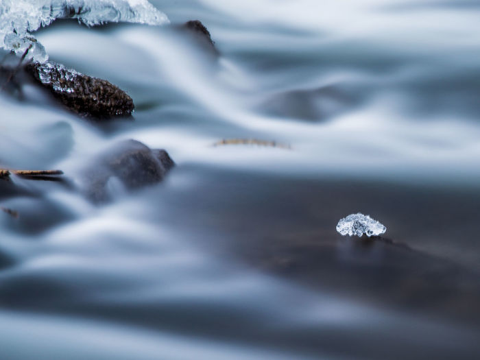 A piece of ice floating among the rushing water. Used a 10 stop filter to make the water look smooth. Freezing Frozen Ice Morning Winter Beauty In Nature Close-up Day Long Exposure Nature No People Outdoors Rapids River Rushing Selective Focus Water