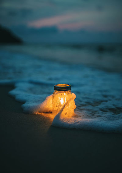 Leaving the sea. Candle jar Sea Land Water Nature Beach No People Sunset Selective Focus Beauty In Nature Sand Orange Color Motion Sky Outdoors Close-up Aquatic Sport Scenics - Nature Wave Light Light And Shadow Lighting Equipment Lights Lighthouse Ocean Ocean View OceanCity Night Nightphotography Nightlife Night Lights Night Photography View Vintage Celebration Jar Nature Nature_collection Nature Photography Naturelovers Nature On Your Doorstep Hello World Happiness Holiday Seascape Sea And Sky Sea Life Seaside Pensive Lifestyles Land