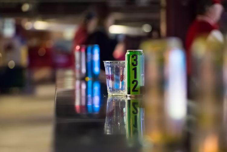 Close-up surface level of tin cans at bar counter