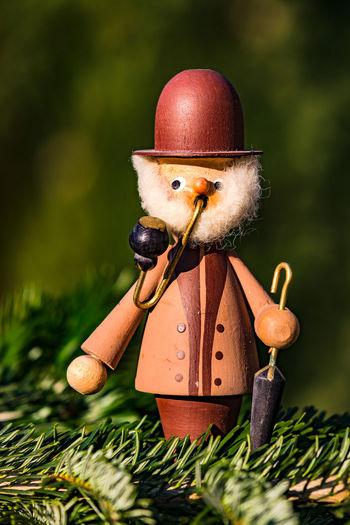 Close-up of figurine on grass